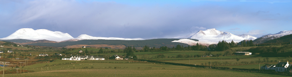 A panorama picture showing some of Arran's majestic mountains, covered in snow, from Kilpatrick